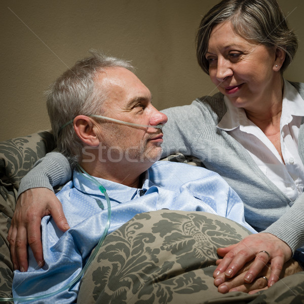 Ill old man lying bed with wife Stock photo © CandyboxPhoto