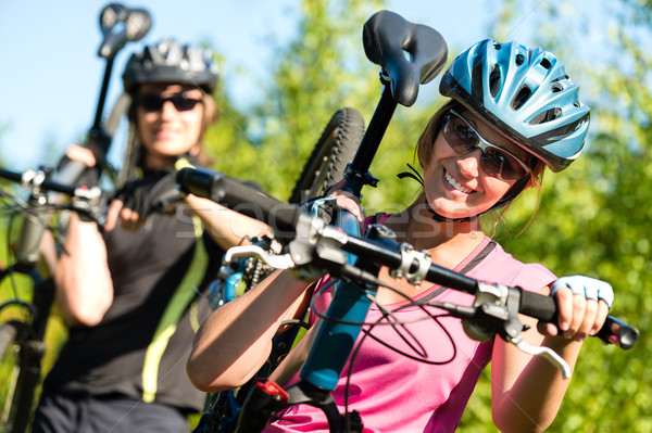 Sporty couple carrying their mountain bikes Stock photo © CandyboxPhoto