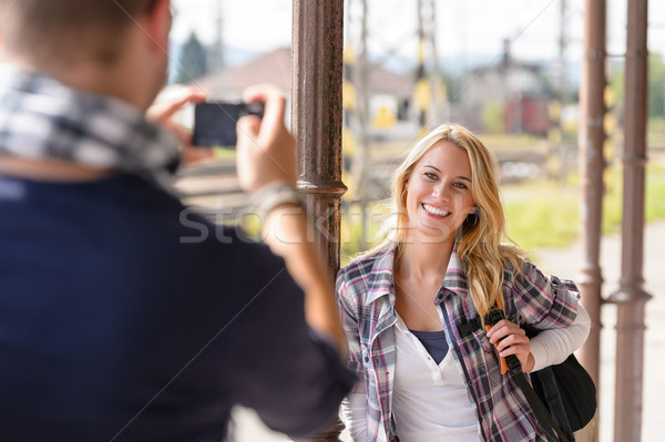 Woman smiling man taking her picture vacation Stock photo © CandyboxPhoto