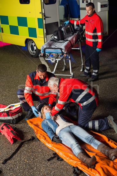 чрезвычайных команда помогают раненый мотоцикл драйвера Сток-фото © CandyboxPhoto