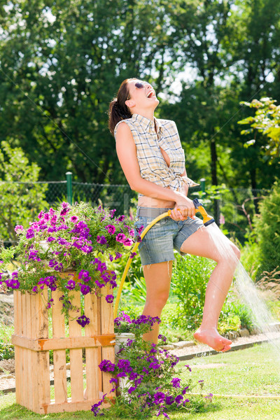 Summer garden smiling woman watering hose flower grass Stock photo © CandyboxPhoto