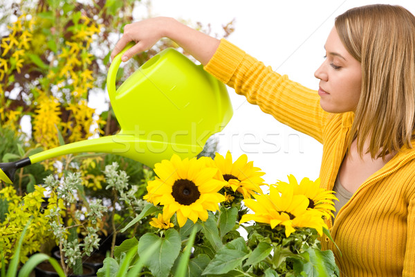 Stock photo: Gardening - woman pouring water to flowers