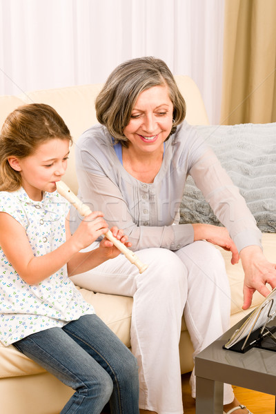 Grandmother teach young girl play flute happy Stock photo © CandyboxPhoto