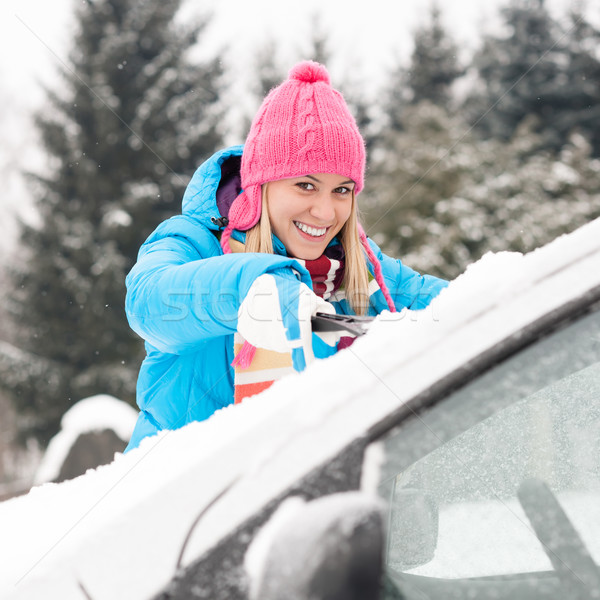 Woman cleaning car windshield of snow winter Stock photo © CandyboxPhoto