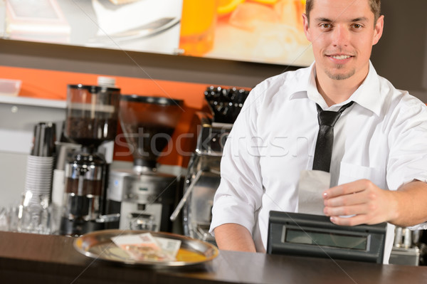 Handsome smiling male waiter giving receipt CZK Stock photo © CandyboxPhoto