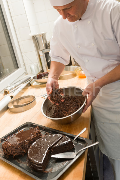 Cook adding chocolate sauce cake in kitchen Stock photo © CandyboxPhoto
