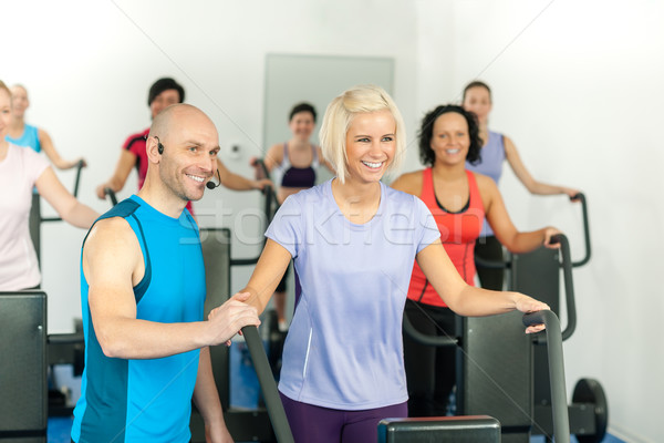 Fitness instructor leading gym people exercise Stock photo © CandyboxPhoto