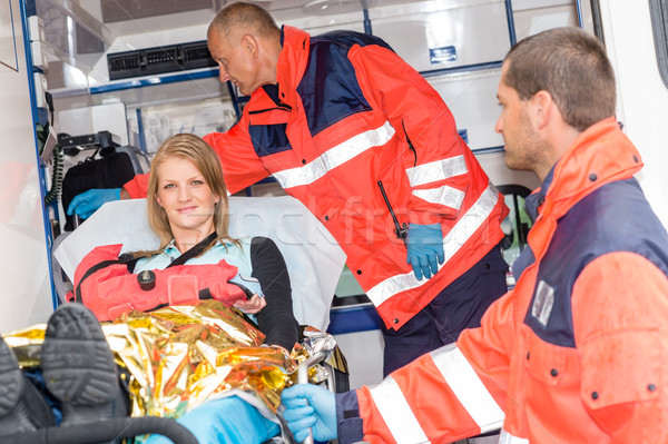 Woman with broken arm in ambulance paramedics Stock photo © CandyboxPhoto