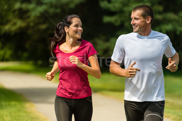 Cheerful Caucasian couple running outdoors Stock photo © CandyboxPhoto