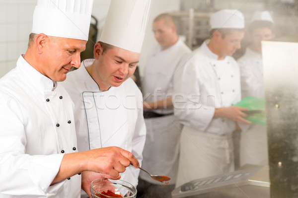 Professional kitchen chef cook add spice food Stock photo © CandyboxPhoto