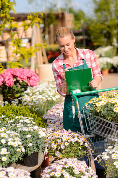 Garden center woman check flowers write notes Stock photo © CandyboxPhoto