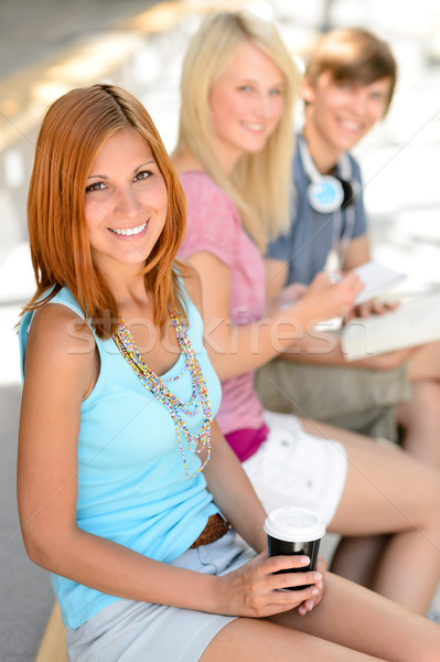 Three smiling student friends sitting summer Stock photo © CandyboxPhoto