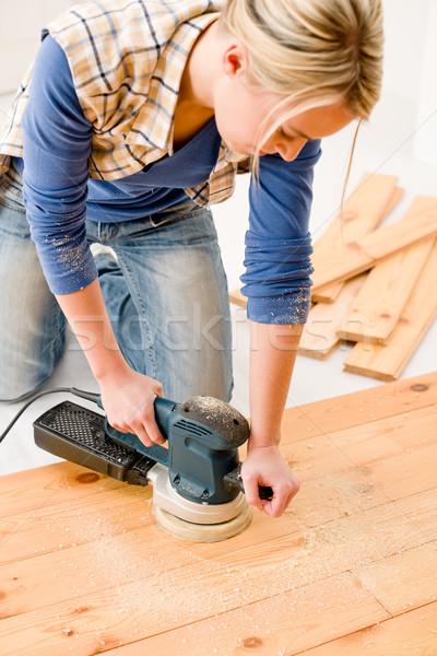 Home improvement - handywoman sanding wooden floor Stock photo © CandyboxPhoto