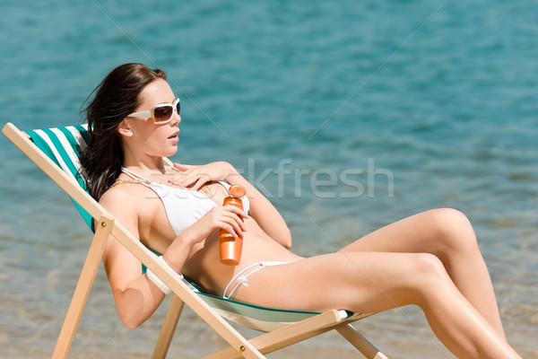 Stock photo: Summer slim woman sunbathing in bikini deckchair