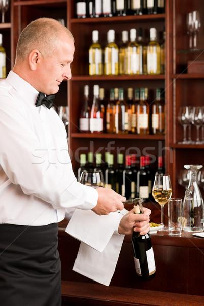 Wine bar waiter opening bottle restaurant Stock photo © CandyboxPhoto