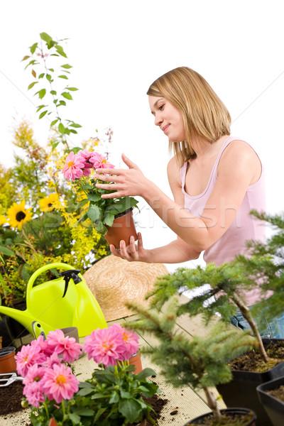 Gardening - Happy woman holding flower pot Stock photo © CandyboxPhoto