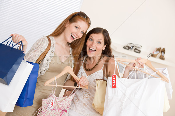 Fashion shopping -  Two happy young woman choose clothes  Stock photo © CandyboxPhoto