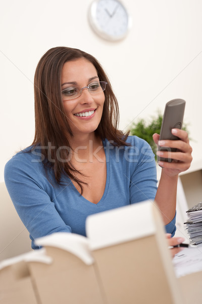 Young female architect working at office holding phone Stock photo © CandyboxPhoto