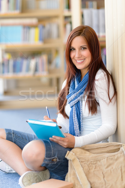 Happy student with notepad at high-school library Stock photo © CandyboxPhoto