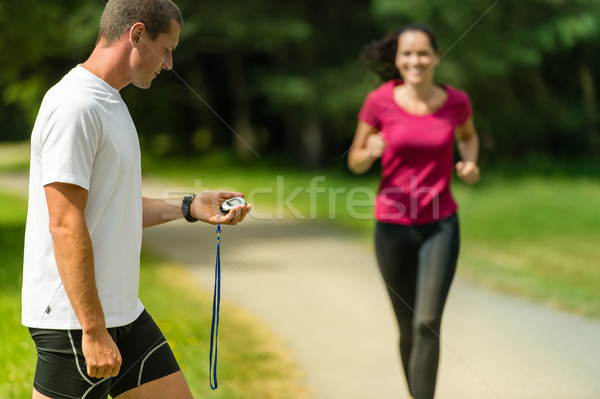 Portrait of male coach timing runner outdoors Stock photo © CandyboxPhoto