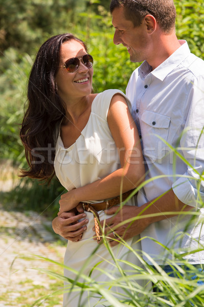 Couple cuddling and flirting in a park Stock photo © CandyboxPhoto