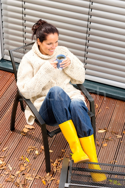 Cheerful woman drinking tea autumn rubber boots Stock photo © CandyboxPhoto