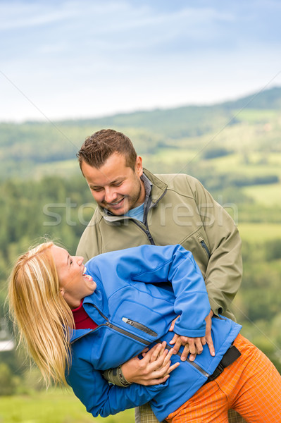 Smiling young couple posing outdoors Stock photo © CandyboxPhoto