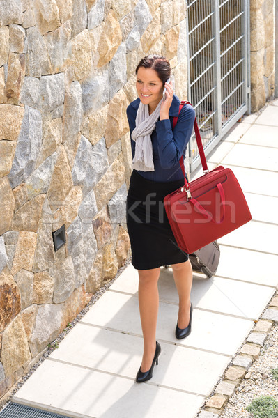 Elegance woman leaving home luggage calling phone Stock photo © CandyboxPhoto