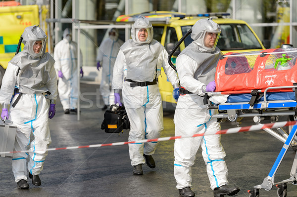 Biohazard team with stretcher walking on street Stock photo © CandyboxPhoto