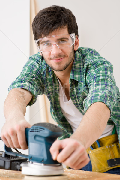 Home improvement - handyman sanding wooden floor Stock photo © CandyboxPhoto