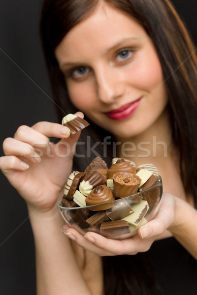 Chocolate - portrait young woman enjoy candy Stock photo © CandyboxPhoto