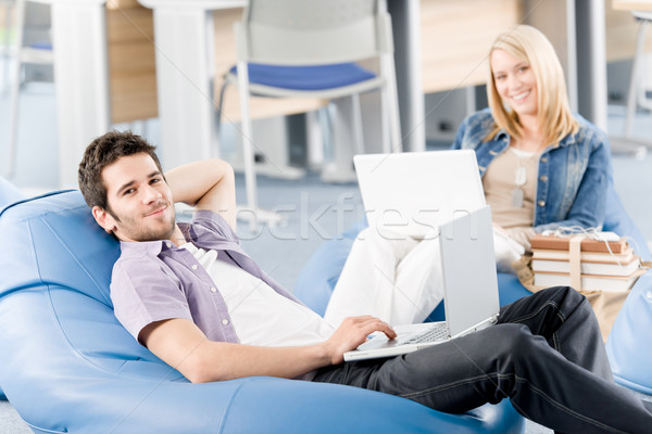Young students at high-school relax with laptop Stock photo © CandyboxPhoto