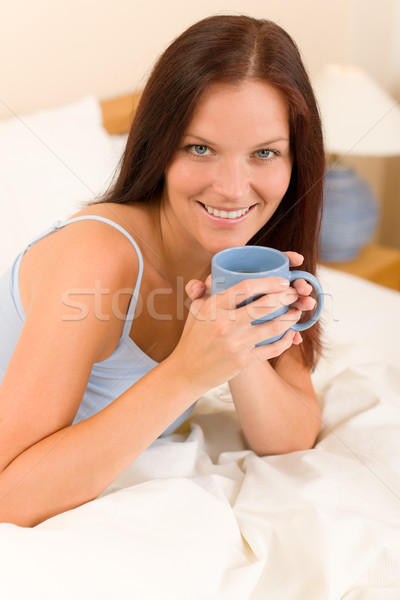 Bedroom - young woman drink coffee in bed Stock photo © CandyboxPhoto