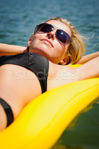 Summer woman relax on water floating mattress Stock photo © CandyboxPhoto