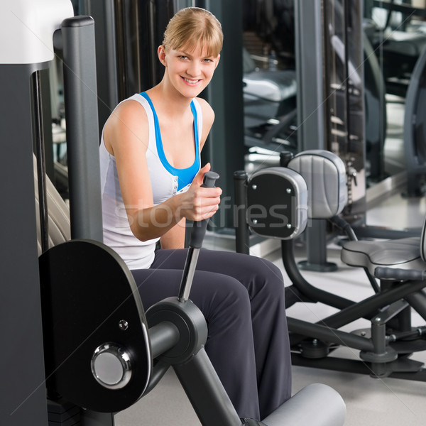 Young woman at fitness center exercise machine Stock photo © CandyboxPhoto