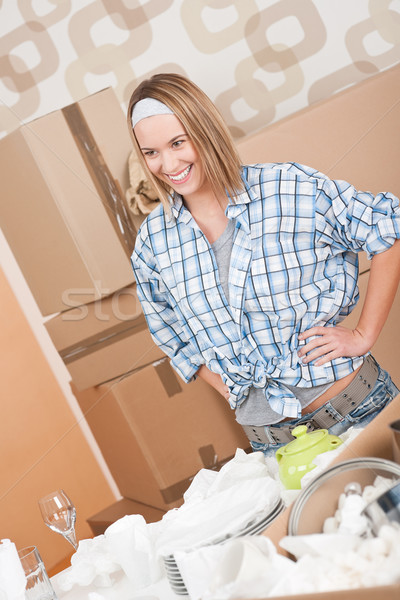 Moving house: Woman unpacking box Stock photo © CandyboxPhoto