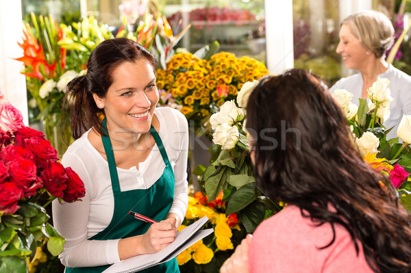 Happy florist writing flower shop talking customer Stock photo © CandyboxPhoto