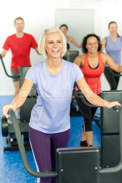 Fiatal fitnessz nő futópad fut osztály tornaterem Stock fotó © CandyboxPhoto