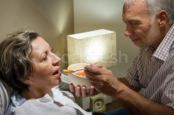 Szerető nyugdíjas férj etetés beteg feleség Stock fotó © CandyboxPhoto