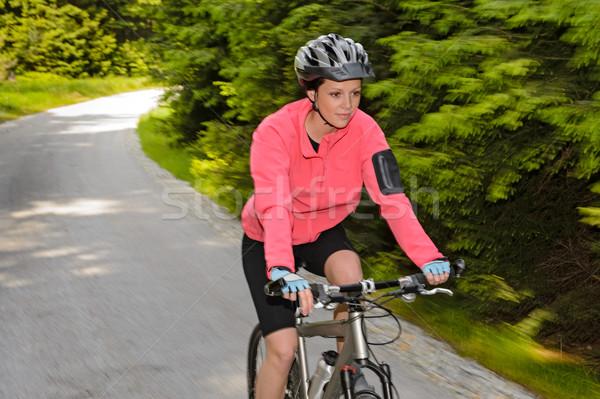 Woman mountain biking motion blur cycling path Stock photo © CandyboxPhoto