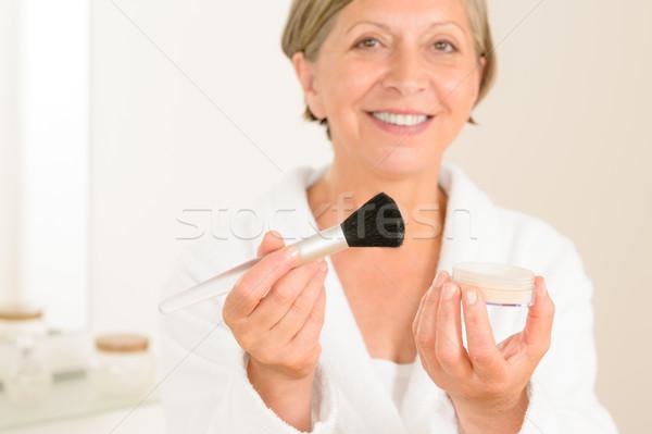 Mature woman hold brush and make-up powder Stock photo © CandyboxPhoto