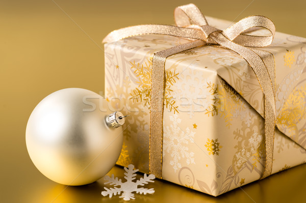 Christmas present and bauble on gold background Stock photo © CandyboxPhoto