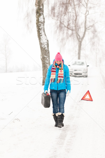Woman carrying gas can snow car trouble Stock photo © CandyboxPhoto