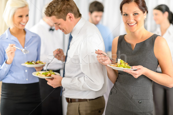 Smiling business woman during company lunch buffet Stock photo © CandyboxPhoto