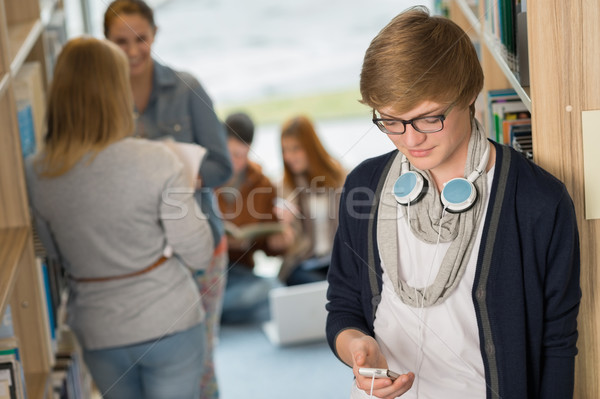 Student with headphones in college library Stock photo © CandyboxPhoto