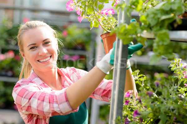 Smiling woman working in garden center sunny Stock photo © CandyboxPhoto