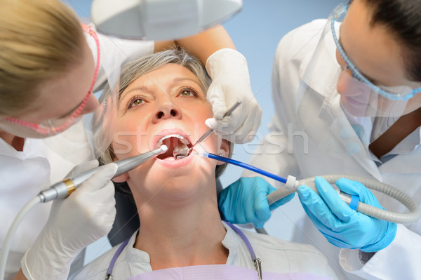 Senior woman patient dental check dentist team Stock photo © CandyboxPhoto