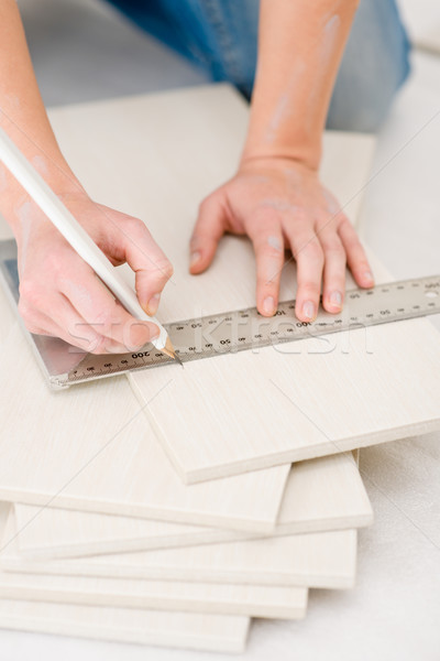 Home improvement - handywoman measuring tile Stock photo © CandyboxPhoto