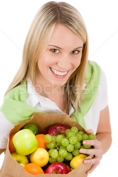 Stock photo: Healthy lifestyle - woman with fruit shopping paper bag