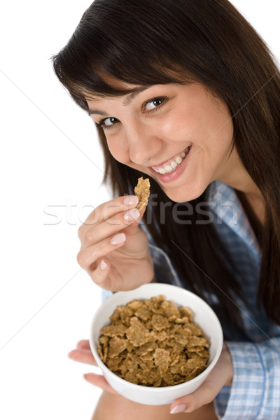 Smiling woman eat whole wheat cereal in pajamas Stock photo © CandyboxPhoto
